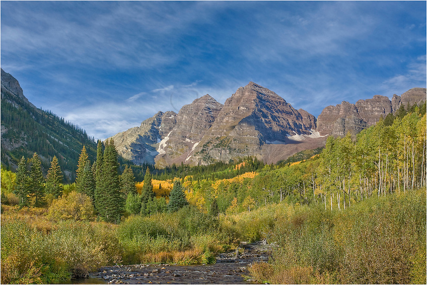 From the Maroon Bells Wilderness Area, this landscape image of two of Colorado's iconic 14ers, Maroon Peak and North Maroon Peak, was taken in early Autumn. The air was cool and crisp, and it was a perfect morning for exploring. I had already walked to Crater Lake and was making my way back to Maroon Creek - enjoying every minute of this trip.
