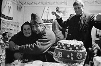 ROMANIA / Maramures / Calinesti / January 2003..Revelers at a winter wedding celebration lasting long into the night in snowbound Calinesti deep in the Maramures hills.  ..© Davin Ellicson / Anzenberger..