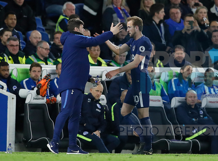 Harry Kane of Tottenham greeted by Mauricio Pochettino manager of Tottenham as he is substituted during the premier league match at the Amex Stadium, London. Picture date 17th April 2018. Picture credit should read: David Klein/Sportimage