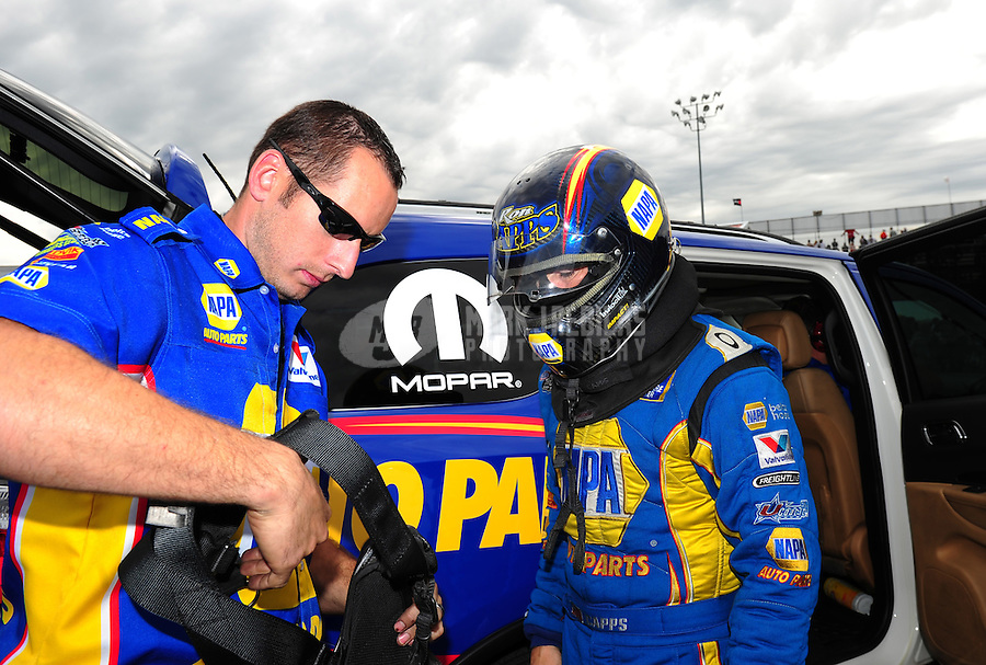Sept. 30, 2011; Mohnton, PA, USA: NHRA funny car driver Ron Capps (right) with a crew member during qualifying for the Auto Plus Nationals at Maple Grove Raceway. Mandatory Credit: Mark J. Rebilas-