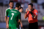 FIFA Referee Alireza Faghani of Iran (R) speaks to Amanov Arslan of Turkmenistan (C) during the AFC Asian Cup UAE 2019 Group F match between Japan (JPN) and Turkmenistan (TKM) at Al Nahyan Stadium on 09 January 2019 in Abu Dhabi, United Arab Emirates. Photo by Marcio Rodrigo Machado / Power Sport Images
