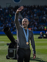 Manchester City manager Josep Guardiola  celebrating winning the Premiership Champions<br /> <br /> Photographer David Horton/CameraSport<br /> <br /> The Premier League - Brighton and Hove Albion v Manchester City - Sunday 12th May 2019 - The Amex Stadium - Brighton<br /> <br /> World Copyright © 2019 CameraSport. All rights reserved. 43 Linden Ave. Countesthorpe. Leicester. England. LE8 5PG - Tel: +44 (0) 116 277 4147 - admin@camerasport.com - www.camerasport.com