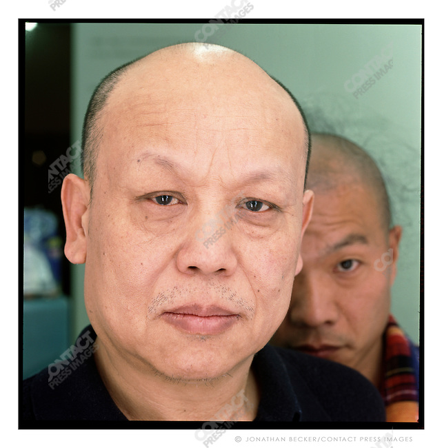 Li Guosheng, owner of the Chinablue Gallery, in Beijing, with photographer Wang Qingsong, Beijing, China, 2007