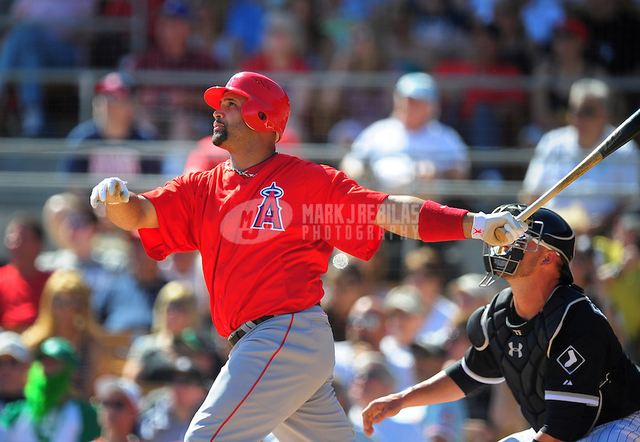Mar. 14, 2012; Phoenix, AZ, USA; Anaheim Angels batter Albert Pujols hits a solo home run in the fifth inning against the Chicago White Sox at The Ballpark at Camelback Ranch. Mandatory Credit: Mark J. Rebilas-