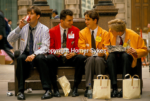 LIFFE, London International Financial Futures Exchange. Young traders having a lunch break. This  was all pre-computer trading, and is where deals were struck, Derivates, Options and Futures were bought and sold by shouting across the trading floor know at the 'Bear Pit' and frantic gesturing. They wore different coloured jackets so that colleagues could pick each other out in the frenzy of a days work.