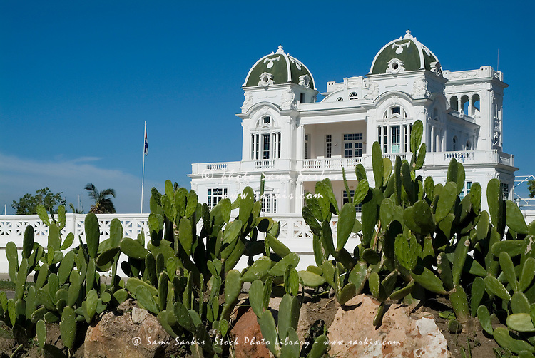 Cacti in front of a grand old colonial-style mansion, Cienfuegos, Cuba.