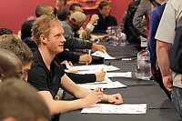 Pictured: Alan Tate signing copies of the new Swansea City FC calendar at the Liberty Stadium, Swansea south Wales. Thursday 02 december 2011<br />
