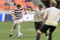 Houston, TX - Friday December 11, 2016: Drew Skundrich (12) of the Stanford Cardinal brings the ball up the field with Ian Harkes (16) of the Wake Forest Demon Deacons in pursuit at the NCAA Men's Soccer Finals at BBVA Compass Stadium in Houston Texas.