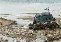 Pictured: A car is half submerged in debris by the beach in Nikiti Chalkidikis, northern Greece. Wednesday 27 June 2018<br /> Re: Flashflooding has been caused by storm Nefeli in parts of Greece.