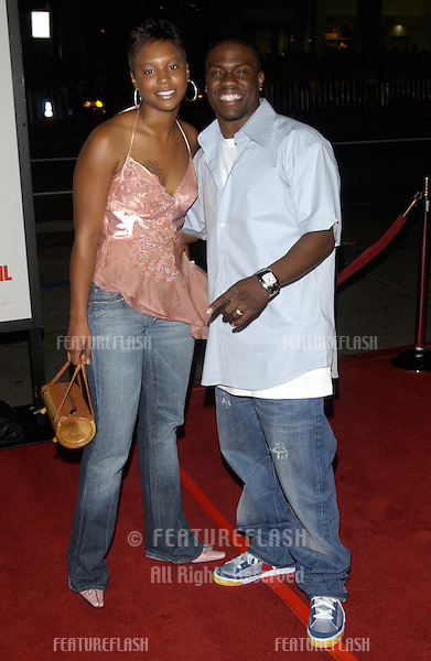 Actor KEVIN HART & wife at the world premiere, in Hollywood, of Walking Tall..March 29, 2004