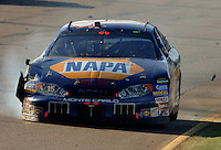 Nov 13, 2005; Phoenix, Ariz, USA;  Nascar Nextel Cup driver Michael Waltrip driver of the #15 Napa Chevy blows a tire during the Checker Auto Parts 500 at Phoenix International Raceway. Mandatory Credit: Photo By Mark J. Rebilas