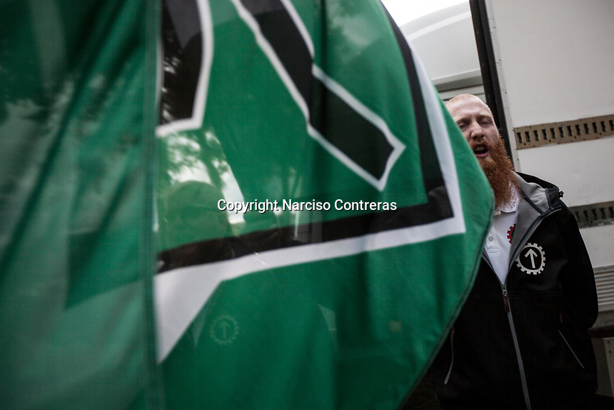 August 25, 2018: A supporter of the neo_Nazi Nordic Resistance Movement NRM (Nordiska motståndsrörelsen) chants slogans during a demonstration at the Kungsholmstorg square in Stockholm, Sweden. An estimate of 200 supporters of the neo-Nazi organisation held a six-hour rally guarded by a strong police deployment.