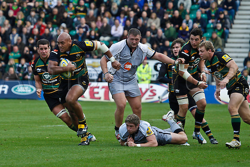 30.10.2010 Aviva Premiership Rugby Northampton Saints v Newcastle Falcons.  Northampton's Soane Tonga'uiha breaks the tackle of Newcastle's Luke Eves.