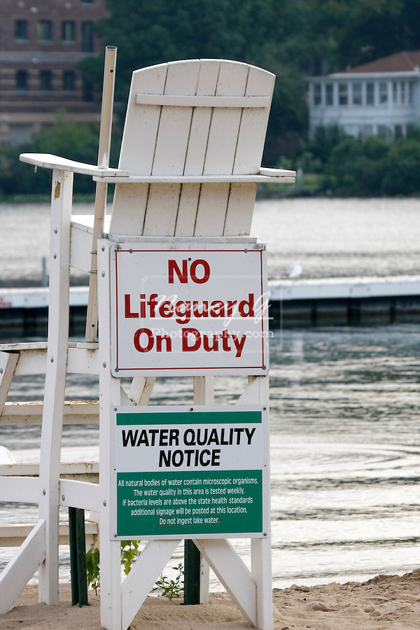 No Lifeguard on duty sign on a lifeguard tower in a swimming are on a lake in Wisconsin