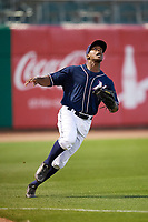 Northwest Arkansas Naturals left fielder Elier Hernandez (21) tracks a fly ball during a game against the Midland RockHounds on May 27, 2017 at Arvest Ballpark in Springdale, Arkansas.  NW Arkansas defeated Midland 3-2.  (Mike Janes/Four Seam Images)