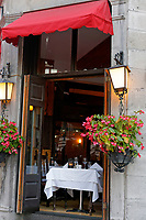 Romantic table set for two in the open window of a restaurant in Old Montreal, Quebec, Canada
