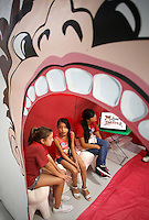 NWA Democrat-Gazette/DAVID GOTTSCHALK Keirstyn Horn (from left), Elizabeth Pacheco and Sandra Guerra, all fifth grade students at Harp Elementary School, learn about the mouth, tongue and teeth Friday, September 11, 2015 along with other students as they participate in the Mouth station of the Farm and You agricultural program at the school in Springdale. Students at the school rotated through nine stations with different interactive activities about the importance of food, farms and good health.