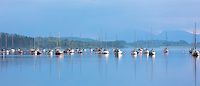 Yachts moored on Loch Creran, making reflections on the sea loch on west coast of Scotland, near Creagan in the Argyll and Bute region