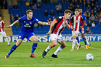 Ched Evans of Sheffield United shields the ball from Greg Halford of Cardiff City during the Sky Bet Championship match between Cardiff City and Sheffield United at Cardiff City Stadium, Cardiff, Wales on 15 August 2017. Photo by Mark  Hawkins / PRiME Media Images.