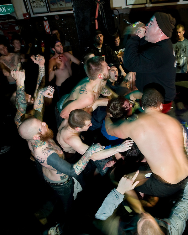 October 10, 2010 - Hardcore fans sing along to Joe Riverside Mahiques from the straight edge hardcore band Rhinoceros at the Mohawk Place, Buffalo, NY. Straight edge is a belief system of no smoking, no drinking, and no drugs.