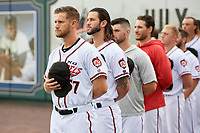 Richmond Flying Squirrels relief pitchers Chase Johnson (57) and Kieran Lovegrove (40) during the national anthem before an Eastern League game against the Binghamton Rumble Ponies on May 29, 2019 at The Diamond in Richmond, Virginia.  Binghamton defeated Richmond 9-5 in ten innings.  (Mike Janes/Four Seam Images)