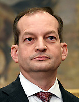 United States Secretary of Labor Alex Acosta prior to the arrival of US President Donald J. Trump who will sign an Executive Order to promote healthcare choice and competition in the Roosevelt Room of the White House in Washington, DC on Thursday, October 12, 2017.  The President's controversial plan is designed to make lower-premium health insurance plans more widely available.<br /> Credit: Ron Sachs / Pool via CNP /MediaPunch
