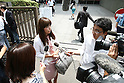 "July 2, 2010 - Tokyo, Japan - Rina Bovrisse's, former senior Retail manager at Prada Japan, speaks to reporters prior the 2nd Hearing of Prada Japan Case at Tokyo District Court, Japan, on July 2, 2010. Rina Bovrisse, joined by two other ""former Prada  Japan employees, is suing the Italian fashion designer after she was placed on involuntary leave last November. The 36-year-old Japanese national had claimed she was asked to 'eliminate' around 15 managerial staff who was categorized as ""aged, ugly, fat, bad body shape, bad teeth, disgusting, and not cute."""