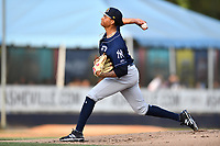 Charleston RiverDogs starting pitcher Luis Gil (18) delivers a pitch during a game against the Asheville Tourists at McCormick Field on May 22, 2019 in Asheville, North Carolina. The Tourists defeated the RiverDogs 10-8. (Tony Farlow/Four Seam Images)