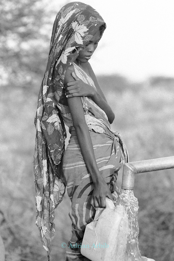 Somali girl at a water pump in Wajir, a town on the  Kenya /Somalia border populated mostly by Somalis.  Northern East Kenya.