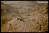 Train with gondolas filled with rock on Monarch switchbacks.<br /> D&amp;RGW  Monarch Switchbacks, CO