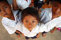 Cambodia, Siem Reap, portrait of school children taken from above Few years ago photographers Anthony Asael and Stepahnie Rabemiafara dreamed a dream that seemed quite imposible: to visit every country of the World promoting arts and tolerance among children and, of course, taking photographs of them. With little money and resources but an impressing will, the duo got an astonishing goal. In four years they visited 300 schools in 192 countries where kids participating of the project created 18,000 pieces of artwork. <br />