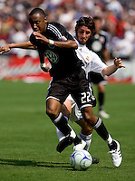 Real Madrid midfielder (23) Esteban Granero fouls DC United midfielder (22) Rodney Wallace during their friendly at FedEx Field in Landover, Maryland.  Real Madrid defeated DC United, 3-0.