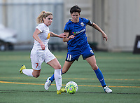 Seattle, WA - Saturday July 16, 2016: McCall Zerboni, Keelin Winters during a regular season National Women's Soccer League (NWSL) match between the Seattle Reign FC and the Western New York Flash at Memorial Stadium.