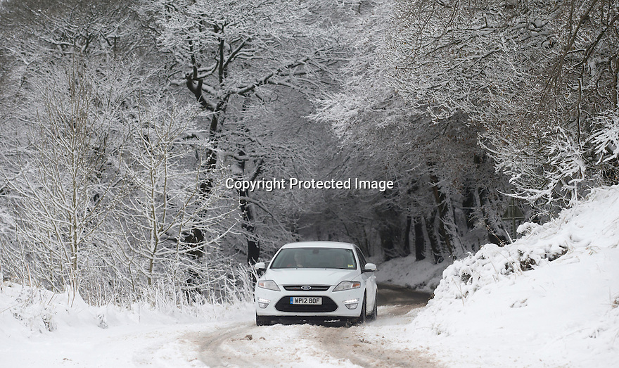 18/11/16<br /> <br /> A driver fails to make his way up a snowy road below Mam Tor. <br /> <br /> Heavy snowfall turns the Peak District near Castleton into a winter wonderland.<br /> All Rights Reserved F Stop Press Ltd. (0)1773 550665   www.fstoppress.com