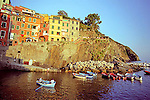 Rowers enjoy their evening boat ride during sunset in the Cinque Terre town of Riomaggorie, Italy.