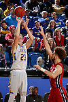 BROOKINGS, SD - DECEMBER 31:  Reed Tellinghuisen #23 from South Dakota State University spots up for a jumper over Trey Burch-Manning #12 from the University of South Dakota during their game Saturday afternoon at Frost Arena in Brookings. (Dave Eggen/Inertia)