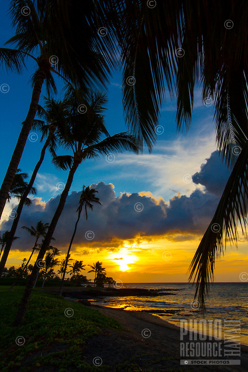 Sunset at a black sand beach between Mauna Lani and Fairmont Orchid Resorts on the Big Island.