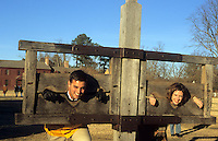 Colonial Williamsburg Virginia from the 1700s a tourist couple plays in stockade.