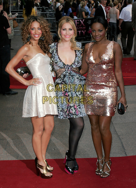 "AMELLE BERRABAH, HEIDI RANGE & KEISHA BUCHANAN of Sugababes.Arrivals at the ""Sex And The City: The Movie"" World Premiere, Odeon Leicester Square, London, England, UK. .May 12th 2008 .SATC full length gold strapless dress bronze sequined low cut black patterned print tights pink shoes heels sandals hand on hip.CAP/AH.©Adam Houghton/Capital Pictures."