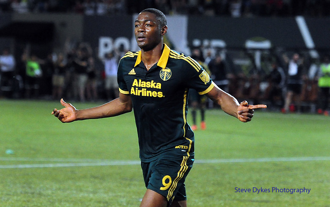 Jun 6, 2015; Portland, OR, USA; Portland Timbers forward Fanendo Adi (9) celebrates after scoring his second goal during the second half of the game against the New England Revolution at Providence Park. The Timbers won the game 2-0. Mandatory Credit: Steve Dykes-USA TODAY Sports