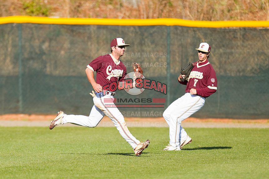 Center fielder Cole Rakar #12 of the College of Charleston Cougars makes a running catch in front of Marty Gantt #7 against the Davidson Wildcats at Wilson Field on March 12, 2011 in Davidson, North Carolina.  The Wildcats defeated the Cougars 8-3.  Photo by Brian Westerholt / Four Seam Images