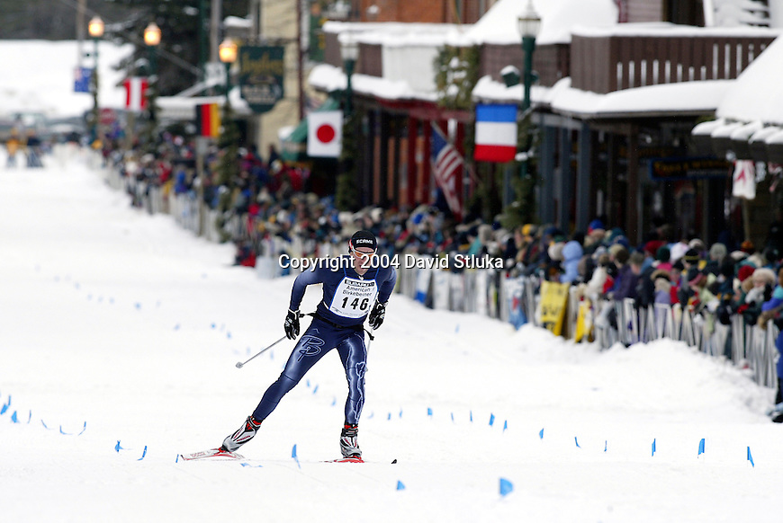 Hayward, Wisconsin - 2/21/04.  A skier races for the finish line in downtown Hayward during the  2004 American Birkebeiner cross-country ski race from Cable to Hayward, Wisconsin. (Photo by David Stluka)