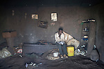 BAKO, ETHIOPIA - NOVEMBER 12: The son of Nodajo Gobena, a farmer who was pushed out from his land when the government sold a leases to Indian farmers in the area, studies English in one of the family houses on November 12, 2010 in Bako, Ethiopia. (Photo by: Per-Anders Pettersson)