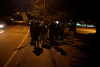 Protesters from Occupy New Hampshire and Occupy the Primary gather at the edge of the St. Anselm College campus before the GOP debate, in Manchester, New Hampshire, on Jan. 7, 2012.  The campus was closed to non-residents and non-students until 6pm.