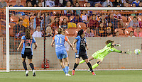 Houston Texas - Janine Beckie (11) of the Houston Dash watches her kick go into the net in the second half putting Houston up 3-1 over Chicago Red Stars on Saturday, April 16, 2016 at BBVA Compass Stadium in Houston Texas.  The Houston Dash defeated the Chicago Red Stars 3-1.