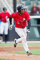 Cleuluis Rondon (5) of the Kannapolis Intimidators hustles down the first base line against the Greenville Drive at CMC-Northeast Stadium on April 6, 2014 in Kannapolis, North Carolina.  The Intimidators defeated the Drive 8-5.  (Brian Westerholt/Four Seam Images)