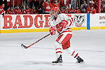 MADISON, WI - FEBRUARY 11: Meaghan Mikkelson #27 of the Wisconsin Badgers women's hockey team shoots the puck against the Ohio State Buckeyes at the Kohl Center on February 11, 2007 in Madison, Wisconsin. The Badgers beat the Buckeyes 3-2. (Photo by David Stluka)