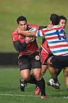 Niva Ta'ausot ries to fend off the tackle of Mike Pehi. Air New Zealand Air NZ Cup warm-up rugby game between the Counties Manukau Steelers & Tasman Mako's, played at Growers Stadium Pukekohe on Sunday July 20th 2008..Counties Manukau won the match 30 - 7.