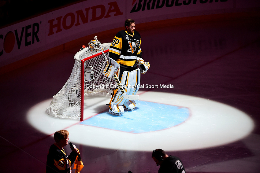 May 31, 2017: Pittsburgh Penguins goalie Matt Murray (30) stands at his net during the signing of the national anthem at  game two of the National Hockey League Stanley Cup Finals between the Nashville Predators  and the Pittsburgh Penguins, held at PPG Paints Arena, in Pittsburgh, PA. The Penguins defeat the Predators 4-1 and lead the series 2-0. Eric Canha/CSM
