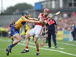David Mc Inerney of Clare in action against Bill Cooper of Cork during their Munster senior hurling final at Thurles. Photograph by John Kelly.